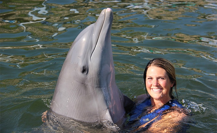 Woman hugging a dolphin